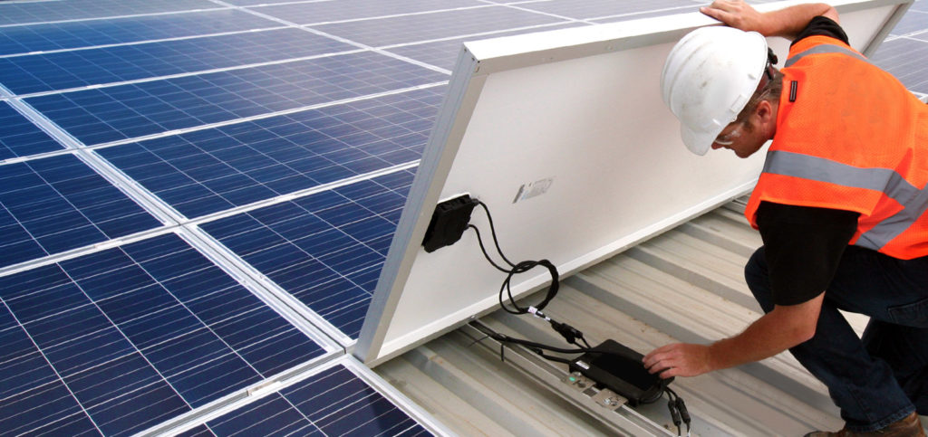 Electrician checking a solar micro-inverter